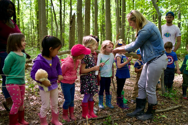 Educator Katie Pollock takes her class outside to experience the textures and smells of plants growing at one of the edible forest garden sites.