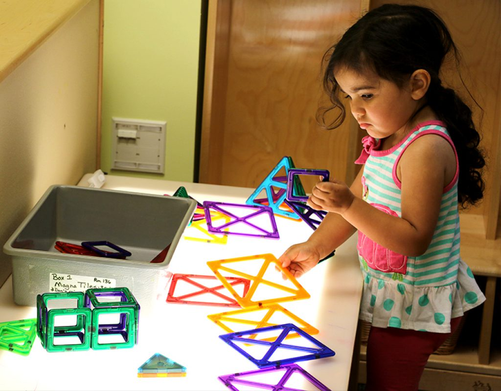 Student completes puzzle activity at the UD Lab School
